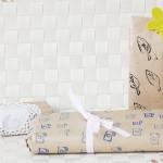 Geschenkpapier mit Stempelmotiven verzieren